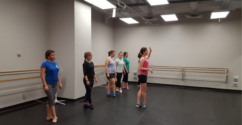Beginner adult dancers working on their solos