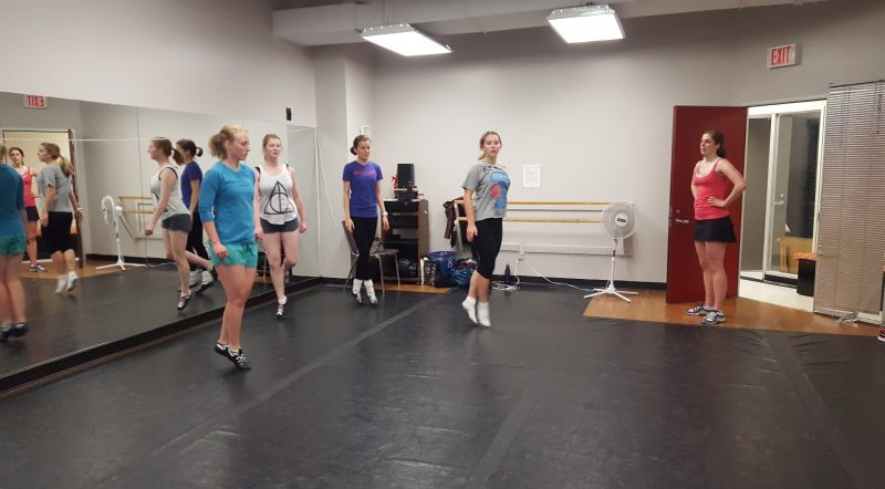 Advanced adult dancers learning a slip jig