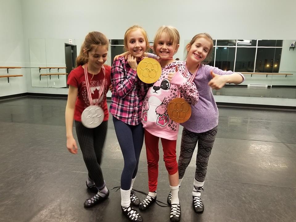 Intermediate Irish dancers with their Olympic medals