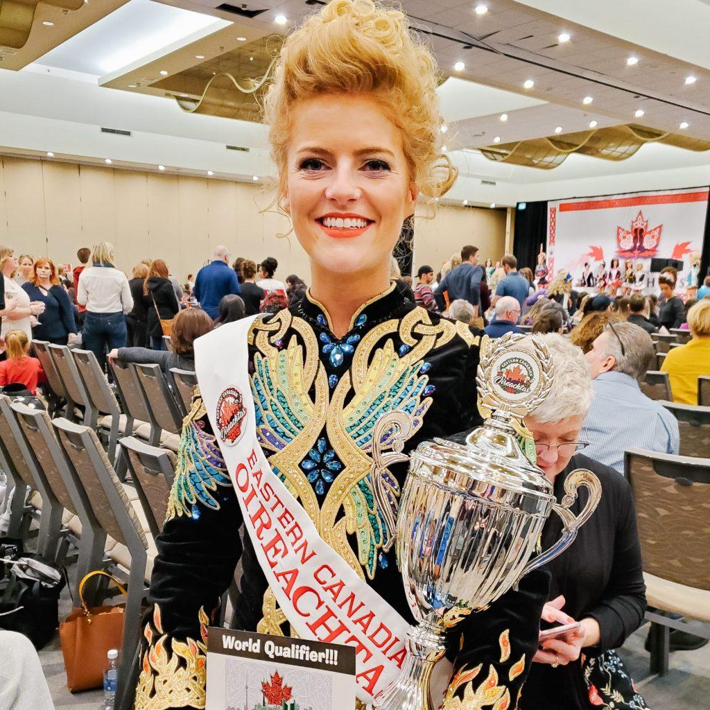 Irish dancer holding awards