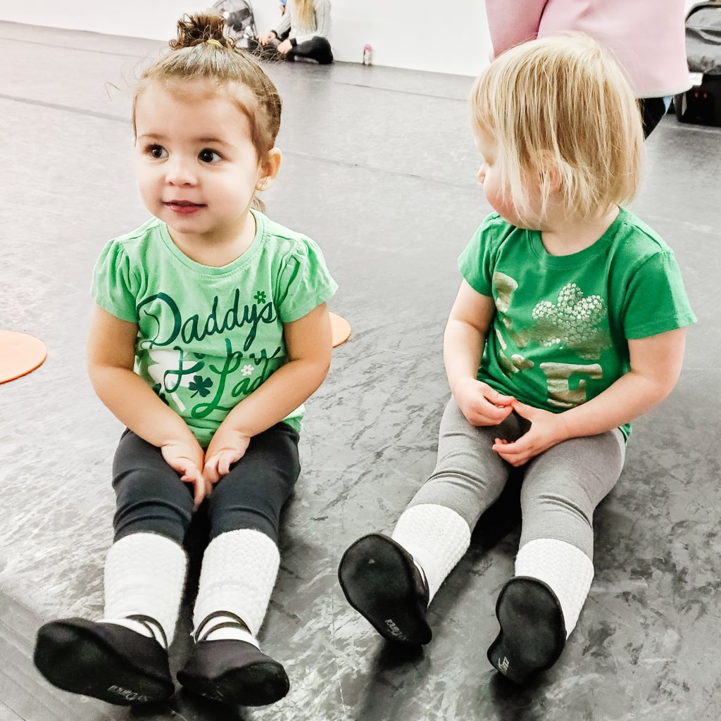 Two toddlers in dance class with St. Patrick's Day shirts